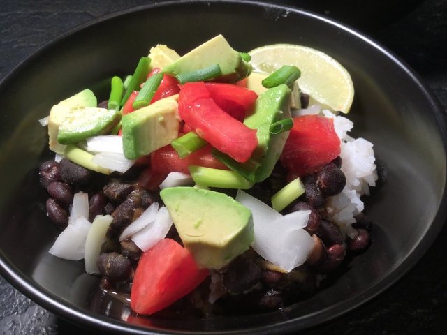 Black beans and rice with avocado, tomatoes and sweet onions make a great