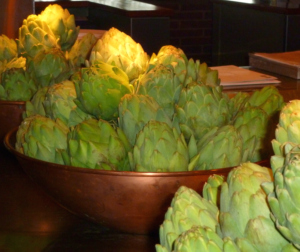 One medium cooked artichoke has 10.3 grams of fiber.