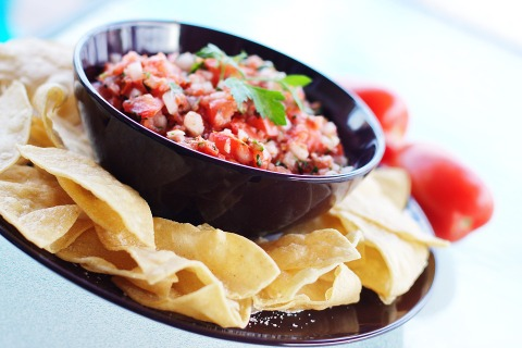 Salsa and chips can be a festive snack or appetizer to share with friends and family.